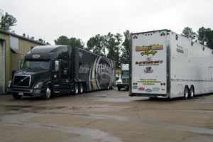 Felix the Cat was hanging out in some pretty high end company. One of the Alan Johnson owned Top Fuel team rigs awaiting its turn.