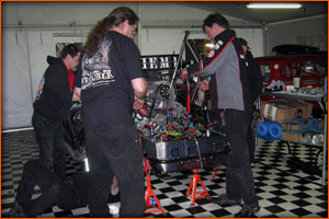 The Trouble Racing crew preparing to get things fixed